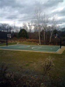 Deco surface with 2 FirstTeam basketball systems constructed by Piretti Sports