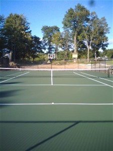 Newly constructed DecoTurf tennis court with FirstTeam basketball system in backcourt