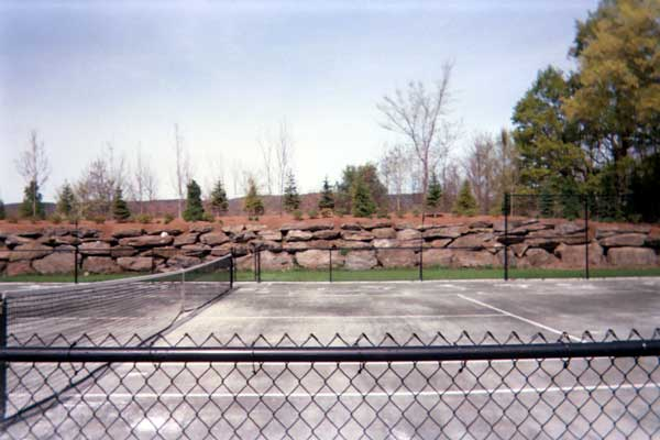 New green Northeast Fast Dry tennis court by Piretti Sports New green Northeast Fast Dry tennis court by Piretti Sport