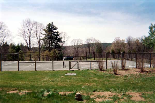 Resurfaced Northeast Fast Dry tennis court, with cedar fence by Piretti Sport