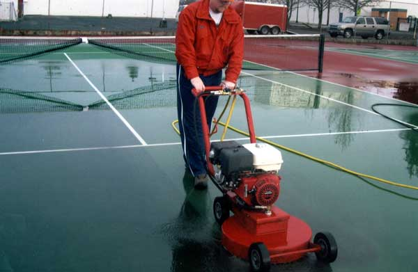 Tennis court surface cleaning