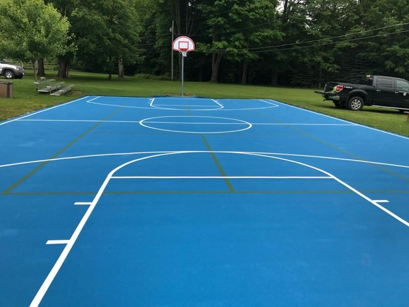 FirstTeam Legacy Select basketball system with Deco surface constructed by Piretti Sports.