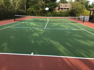 Tennis court installation by Piretti Tennis