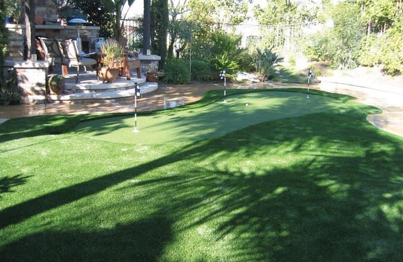 Synthetic putting green installation by Piretti Tennis